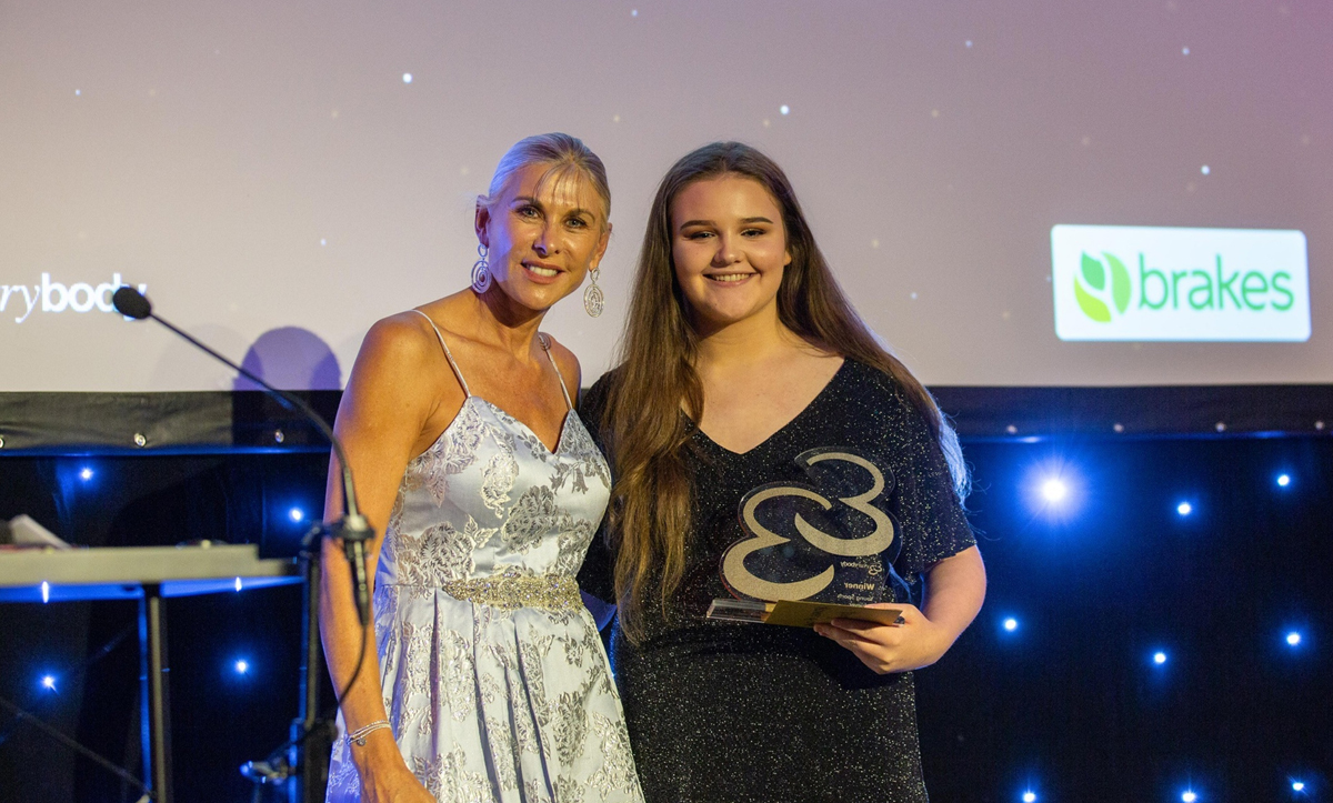 Abby Warren collecting award from Sharon Davies MBE